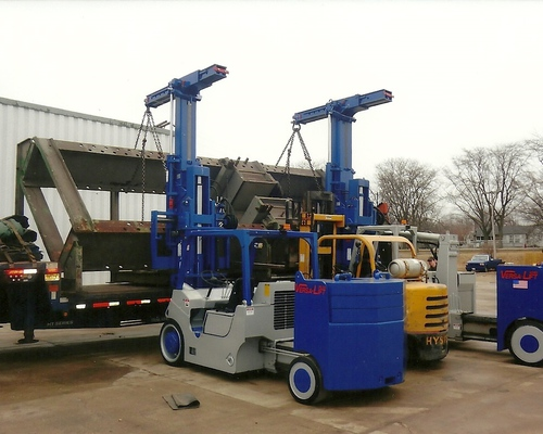 Our 2 Versa Lift forklifts unloading a large wheel press