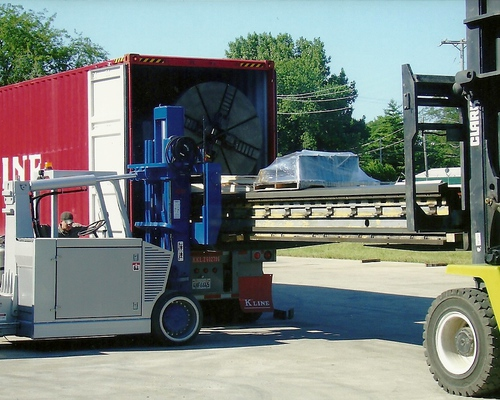Loading a large lathe into a container