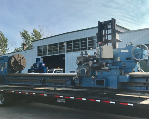 Large lathe being unloaded, 77,000lbs